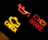 check engine, brake, and oil warning lights on car dash Pride Auto Care Denver Parker Centennial Highlands Ranch